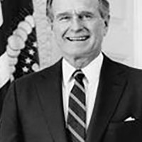George Herbert Walker Bush the President in the 102 congress.