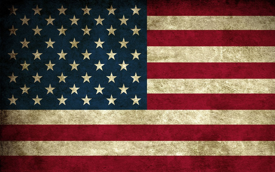 The american flag, a little dirty from a trying life